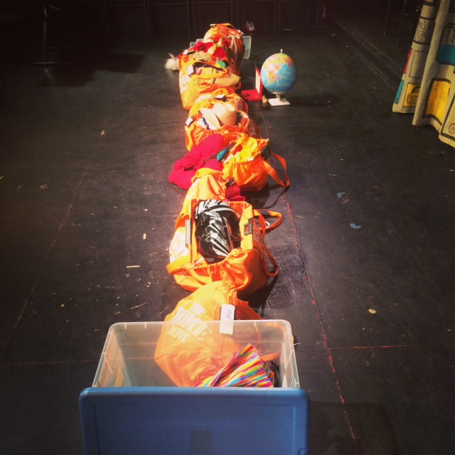 A beautiful row of organized props before a Barrel of Monkeys show. The calm before the storm.