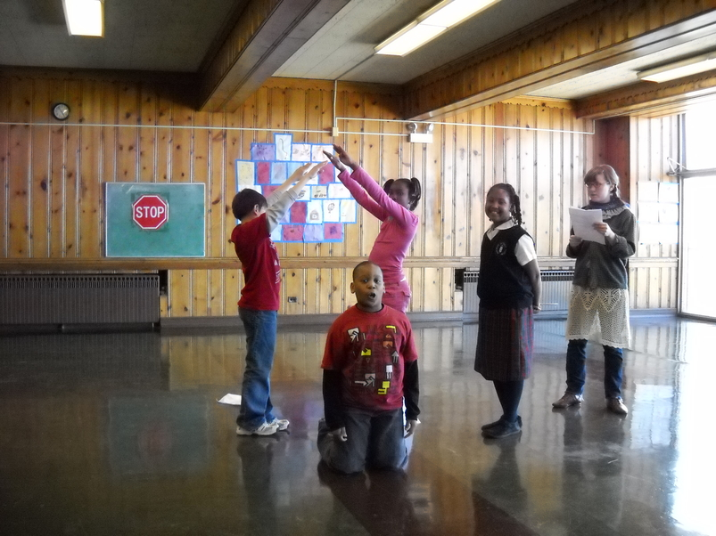 Students acting out a scene during Barrel of Monkeys' Loyola Park after school program in Rogers Park
