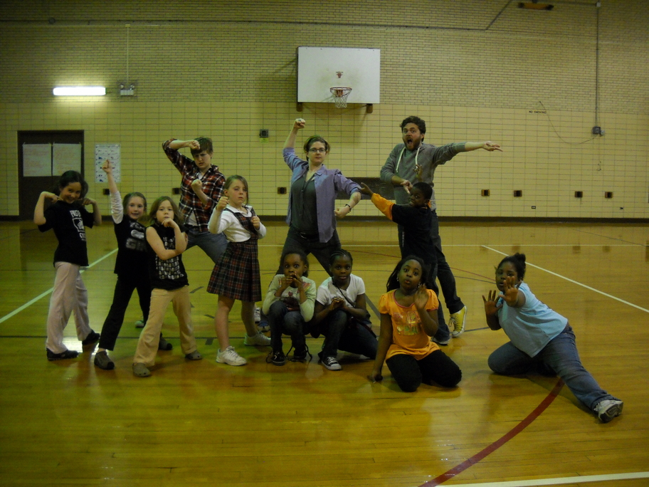 Barrel of Monkey's teaching artists and students posing during the Loyola Park after-school program in Rogers Park