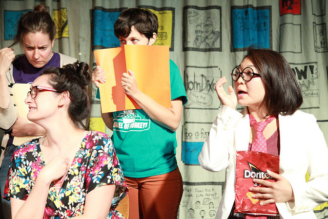 Barrel of Monkeys company members performing Nacho at Work during a performance of That's Weird, Grandma: Stories About Food