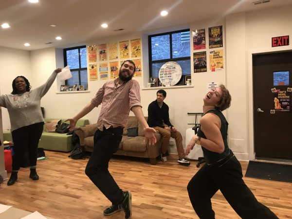 Three Barrel of Monkeys company members rehearsing