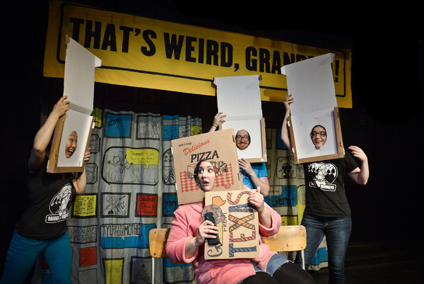 Barrel of Monkeys performers wearing cardboard pizza box masks performing in That's Weird, Grandma.