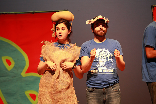 Mary Tilden as Old Man Potaters and Noah Appelbaum as a farm animal during a performance of