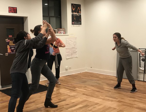 Barrel of Monkeys cast member Steph Vondell protecting the goal during a sketch about lacross in a rehearsal in Uptown